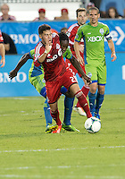 August 10, 2013: Toronto FC midfielder Jonathan Osorio #21 and Seattle Sounders FC midfielder Shalrie Joseph #21 in action during an MLS regular season game between the Seattle Sounders and Toronto FC at BMO Field in Toronto, Ontario Canada.<br /> Seattle Sounders FC won 2-1.