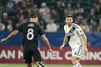 CARSON, CA - SEPTEMBER 15: Dave Romney #4 of the Los Angeles Galaxy stares down Graham Zusi #8 of Sporting Kansas City during a game between Sporting Kansas City and Los Angeles Galaxy at Dignity Health Sports Complex on September 15, 2019 in Carson, California.
