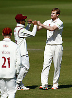 15th April 2021; Emirates Old Trafford, Manchester, Lancashire, England; English County Cricket, Lancashire versus Northants; Tom Taylor of Northamptonshire celebrates with Saif Zaib after he has Keaton Jennings of Lancashire caught by keeper Ricardo Vasconcelos for 13