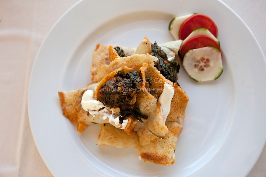 Jambiani, Zanzibar, Tanzania.  Lunch.  Spinach Canelloni, at one of the many small hotels along Zanzibar's eastern, Indian Ocean, coast.