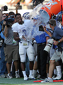 Armwood Hawks wide receiver Alvin Bailey distracts head coach Sean Callahan as teammates dump the water over his head during the fourth quarter of the Florida High School Athletic Association 6A Championship Game at Florida's Citrus Bowl on December 17, 2011 in Orlando, Florida.  Armwood defeated Miami Central 40-31.  (Photo By Mike Janes Photography)