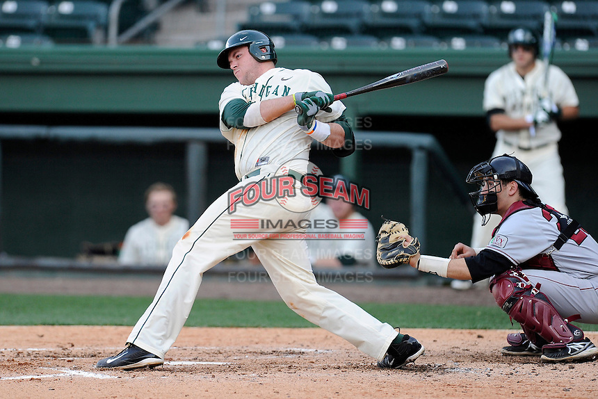 Designated hitter Blaise Salter (11) of the Michigan State Spartans bats in a game against the Harvard Crimson on Saturday, March 15, 2014, at Fluor Field at the West End in Greenville, South Carolina. The catcher is Steve Dill (25). Michigan State won, 4-0. (Tom Priddy/Four Seam Images)