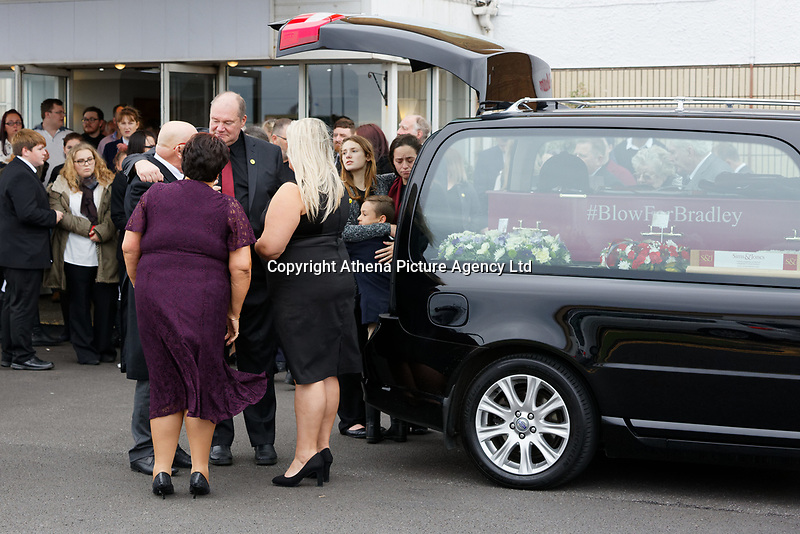 """Pictured: Byron John (3rd L) the father of Bradley and sister Danielle (BACKGROUND) greet mourners at Aberavon Beach Hotel in Port Talbot, Wales, UK. Monday 08 October 218<br /> Re: A grieving father will mourners on horseback at the funeral of his """"wonderful"""" son who killed himself after being bullied at school.<br /> Talented young horse rider Bradley John, 14, was found hanged in the school toilets by his younger sister Danielle.<br /> Their father, farmer Byron John, 53, asked the local riding community to wear their smart hunting gear at Bradley's funeral.<br /> Police are investigating Bradley's death at the 500-pupils St John Lloyd Roman Catholic school in Llanelli, South Wales.<br /> Bradley's family claim he had been bullied for two years after being diagnosed with Attention Deficit Hyperactivity Disorder.<br /> He went missing during lessons and was found in the toilet cubicle by his sister Danielle, 12."""