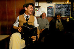 Farmers and countrymen gather at the Kings Head, and also know as the Low House pub, in  Laxfield Suffolk, UK.  Traditional story telling, reciting of poetry and folk music songs are performed in an informal manner every Sunday morning. 1980s