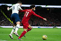 Liverpool's Mohamed Salah shields the ball from Tottenham's Harry Winks <br /> <br /> Photographer Stephanie Meek/CameraSport<br /> <br /> The Premier League - Tottenham Hotspur v Liverpool - Saturday 11th January 2020 - Tottenham Hotspur Stadium - London<br /> <br /> World Copyright © 2020 CameraSport. All rights reserved. 43 Linden Ave. Countesthorpe. Leicester. England. LE8 5PG - Tel: +44 (0) 116 277 4147 - admin@camerasport.com - www.camerasport.com