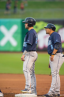 Corpus Christi Hooks coach Ryan Engels (1) talks to outfielder Chas McCormick (20) Wednesday, May 1, 2019, at Arvest Ballpark in Springdale, Arkansas. (Jason Ivester/Four Seam Images)