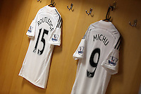Pictured: A collection of the new shirts in the home changing room. Saturday 21 June 2014<br /> Re: Launch of the new home and away kit for Swansea City Football Club at the Liberty Stadium, south Wales.