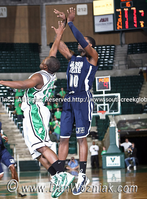 Jackson State Tigers guard Tyrone Hanson (10) goes up for a jump shot  in the game between the Jackson State Tigers and the University of North Texas Mean Green at the North Texas Coliseum,the Super Pit, in Denton, Texas. UNT defeated Jackson 68 to 49
