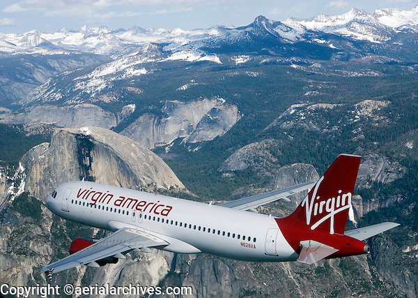 aerial photograph of N628VA, Virgin America Airlines Airbus A320-214, over Yosemite, California, Half Dome in the Background