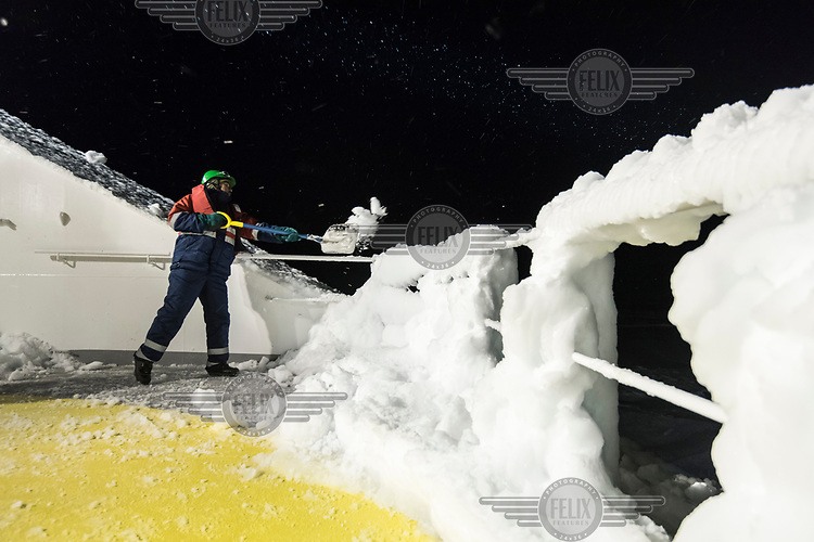 A member of deck crew clears ice from the exterior of the icebreaker and supply ship the 'Fedor Ushakov' as it makes its way through the Barents Sea along the Northern Sea Route.<br /><br /> Modern technologies incorporated into the vessel make it environmentally friendly. Among them are purification systems for bilge water and ballast waters. It has a desalination system that provides drinkable water. The vessel uses fuel with a very low sulfur content and has a purification system for its exhaust gases.