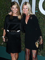 BEVERLY HILLS, CA, USA - OCTOBER 02: Lori Loughlin, Crystal Lourd arrive at Michael Kors Launch Of Claiborne Swanson Franks's 'Young Hollywood' Book held at a Private Residence on October 2, 2014 in Beverly Hills, California, United States. (Photo by Xavier Collin/Celebrity Monitor)