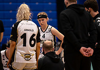 Maddy McVicar of Newcastle Eagles listens to Chris Bunten Head Coach of Newcastle Eagles during the WBBL Championship match between Sevenoaks Suns and Newcastle Eagles at Surrey Sports Park, Guildford, England on 20 March 2021. Photo by Liam McAvoy