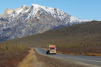 Oversize semi tractor trailer on the Haul Road, Mt. Sukakpak in the distance, Brooks Range, Alaska.