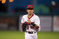 Orem Owlz right fielder Rayneldy Rosario (12) jogs off the field between innings of a Pioneer League game against the Ogden Raptors at Home of the OWLZ on August 24, 2018 in Orem, Utah. The Ogden Raptors defeated the Orem Owlz by a score of 13-5. (Zachary Lucy/Four Seam Images)