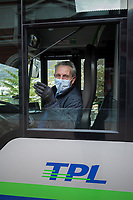 """Switzerland. Canton Ticino. Lugano. Railway station. Bus stop.  A bus driver wears a mask on the face to protect himself from Coronavirus (also called Covid-19). TPL is the public transport company that serves the city of Lugano and the neighbouring municipalities. Due to the spread of the coronavirus, the Federal Council has categorised the situation in the country as """"extraordinary"""". It has issued a recommendation to all citizens to stay at home, especially the sick and the elderly. The Federal Council (German: Bundesrat, French: Conseil fédéral, Italian: Consiglio federale, Romansh: Cussegl federal) is the seven-member executive council that constitutes the federal government of the Swiss Confederation. From March 16 the government ramped up its response to the widening pandemic, ordering the closure of bars, restaurants, sports facilities and cultural spaces. Only businesses providing essential goods to the population – such as grocery stores, bakeries and pharmacies – are to remain open. 27.03.2020 © 2020 Didier Ruef"""