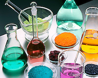 LABGLASS CONTAINING TRANSITION METAL COMPOUNDS<br /> Solids & Solutions in Mortar, Flasks & Watchglass (Variations Available)<br /> Pale green Nickel Chloride in mortar & flask; blue-green Nickel Sulfate in flask & watchglass; crimson Cobalt Chloride in watchglass & flask; orange Sodium Dichromate in watchglass & flask; purple Potassium Permanganate in beaker & watchglass.