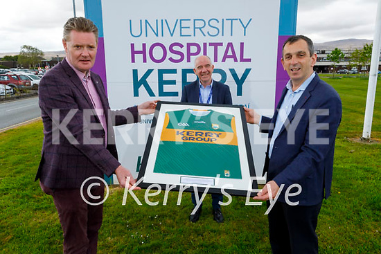 Tim Murphy (Chairman of the Kerry County GAA Committee) and Dr John Rice presenting a Kerry jersey to Fergal Grimes at the UHK as part of a national initiative to recognise Frontline Workers on Tuesday.