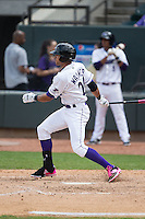 Keenyn Walker (24) of the Winston-Salem Dash follows through on his swing against the Myrtle Beach Pelicans at BB&T Ballpark on May 10, 2015 in Winston-Salem, North Carolina.  The Pelicans defeated the Dash 4-3.  (Brian Westerholt/Four Seam Images)