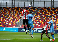 17th October 2020; Brentford Community Stadium, London, England; English Football League Championship Football, Brentford FC versus Coventry City; Emiliano Marcondes of Brentford wins the header from Dominic Hyam of Coventry City from a cross