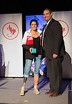 Calgary, AB - June 5 2014 - Michelle Salt receives her Paralympic Ring from Rob Mason, of HBC, during the Celebration of Excellence Paralympic Ring Reception in Calgary. (Photo: Matthew Murnaghan/Canadian Paralympic Committee)
