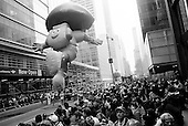 New York, New York<br /> November 26, 2009<br /> USA<br /> <br /> The Macy's Thanksgiving Day Parade in mid-town Manhattan, as Dora the Explorer and other children's cartoon character balloons float through the skyscrapers on 6th Avenue and 42nd Street. Crowds gather to mark the beginning of the Christmas season.