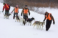 A team of Norwegian *Outdoor Education Students* based in Takotna for the winter help park a team at the Takotna checkpoint on Wednesday during Iditarod 2008