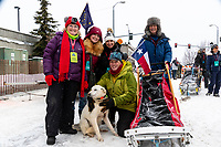 Iditarider and family pose with their musher at 4th Avenue and D street in downtown Anchorage, Alaska on Saturday March 7th during the 2020 Iditarod race. Photo copyright by Cathy Hart Photography.com