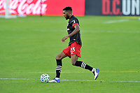 WASHINGTON, DC - NOVEMBER 8: Donovan Pines #23 of D.C. United moves the ball during a game between Montreal Impact and D.C. United at Audi Field on November 8, 2020 in Washington, DC.