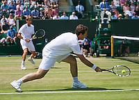 England, London, 28.06.2014. Tennis, Wimbledon, AELTC, Gentlemen's invitational doubles, Paul Haarhuis (NED) and his partner Jacco Eltingh (NED) (R)<br /> Photo: Tennisimages/Henk Koster