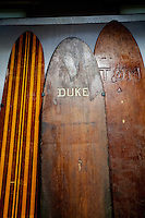 Duke Kahanamoku and other respected watermen's wooden surfboards on display at Bishop Museum, Honolulu, O'ahu.