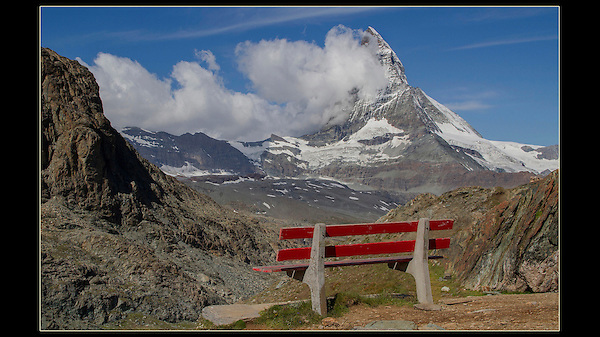 Switzerland, Matterhorn.  <br /> Icons convey information, the Eiffel Tower conveys Paris. Personal icons are subjects I use again and again in my images. Most photographers walk up to this bench, then take their photo. Include the bench, this invites the viewer into your image and gives them a place to dream of sitting one day. of course, the final step is to capture someone sitting on the bench. Photograph unobtrusively.