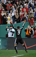 DC United forward Charlie Davies (9) celebrates his second goal of the game with fans.  DC United defeated The Columbus Crew 3-1  at the home season opener, at RFK Stadium, Saturday March 19, 2011.