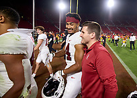 LOS ANGELES, CA - SEPTEMBER 11: Jacob Mangum-Farrar #14 of the Stanford Cardinal walks of the field with coach Eric Sanders after a game between University of Southern California and Stanford Football at Los Angeles Memorial Coliseum on September 11, 2021 in Los Angeles, California.