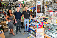 BNPS.co.uk (01202 558833)<br /> Pic: MaxWillcock/BNPS<br /> <br /> Pictured: Stephanie, Ray and Jerry Fisher in the shop.<br /> <br /> Tireless Ray Fisher still works full-time in the motorcycle shop he opened 62 years ago - and he has plenty left in the tank.<br /> <br /> The 85 year old founded Ray Fisher's Brickbits in Christchurch, Dorset, in 1959 after training as a bike mechanic.<br /> <br /> It is a family affair as his two children Gerry, 58, and Stephanie, 54, have both worked solely for him since leaving school aged 16.<br /> <br /> Ray said he had loved bikes since childhood and learnt how to repair them while doing national service in the early 1950s.