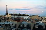 View of Eiffel Tower La tour eiffel over residential buildings. City of Paris. Paris. France