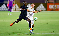 CARSON, CA - SEPTEMBER 06: Daniel Steres #5 of the Los Angeles Galaxy defends against an approaching  Bradley Wright-Phillips #66 of LAFC during a game between Los Angeles FC and Los Angeles Galaxy at Dignity Health Sports Park on September 06, 2020 in Carson, California.