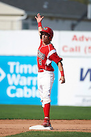 Batavia Muckdogs outfielder Steve Ramos #5 does an air high five to teammates after doubling during a NY-Penn League game against the Auburn Doubledays at Dwyer Stadium on September 3, 2012 in Batavia, New York.  Auburn defeated Batavia 5-3.  (Mike Janes/Four Seam Images)