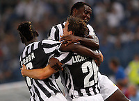 Calcio, Supercoppa di Lega: Juventus vs Lazio. Roma, stadio Olimpico, 18 agosto 2013<br /> Juventus defender Stephan Lichsteiner, of Switzerland, back to camera, celebrates with teammates Paul Pogba, left, and Kwadwo Asamoah during the Italian League Supercup football final match between Juventus and Lazio, at Rome's Olympic stadium,  18 August 2013.<br /> UPDATE IMAGES PRESS/Riccardo De Luca