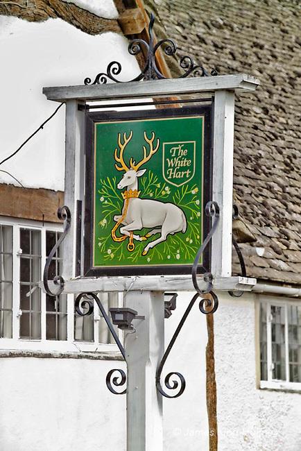 Inn sign of the White Hart public house/restaurant at Fyfield, Oxfordshire, UK