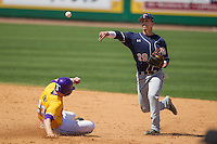Auburn Tigers shortstop Dan Glevenyak #29 turns a double play against the LSU Tigers in the NCAA baseball game on March 24, 2013 at Alex Box Stadium in Baton Rouge, Louisiana. LSU defeated Auburn 5-1. (Andrew Woolley/Four Seam Images).