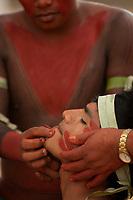 XI Jogos dos Povos Indígenas -    Índios Gavião do Pará mostram o ritual de passagem  da infância para vida adulta, onde o beiço é perfurado recebendo adorno  de madeira representando assim a nova fase da vida.<br /> <br /> O evento, que acontece entre os dias 5 e 12 de novembro, tem como sede o município tocantinense de Porto Nacional, que fica a cerca de 60km da capital, Palmas. São sete dias de competições e apresentações culturais, com a participação de cerca de 1.300 indígenas, de aproximadamente 35 etnias, vindas de todas as regiões do país. São esperados ainda líderes e observadores indígenas de outros países (Argentina, Austrália, Bolívia, Canadá, Equador, EUA, Guiana Francesa, Peru e Venezuela). Foto Paulo Santos10/11/2011Ilha de Porto Real, Porto Nacional, Brasil
