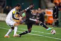 Giancarlo Gonzalez (15) of Columbus Crew keeps track of Eddie Johnson (7) of D.C. United during a MLS game at RFK Stadium in Washington, DC.  D.C. United lost to the Columbus Crew, 3-0.
