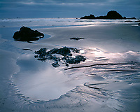 Light breaking through storm clouds on the Pacific Ocean at Ruby Beach; Olympic National Park, WA