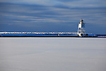 Early morning view of breakwater and lighthouse in winter - Grand Marais, Minnesota.