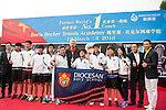 Tennis legend Boris Becker poses for a photograph with the Diocesan Boy's School during the press conference for the opening of Boris Becker Tennis Academy at Mission Hills Resort on 19 March 2016, in Shenzhen, China. Photo by Lucas Schifres / Power Sport Images