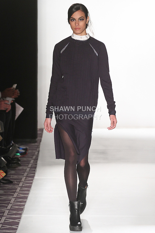 Model walks runway in an outfit from the Auma Fall Winter 2015 collection by Gloria Auma, during the Emerging Designers Fall Winter 2015 fashion show for  Fashion Gallery New York Fashion Week Fall 2015.