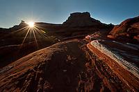 The sun sets over canyons near Moab, Utah.