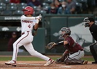 Arkansas shortstop Jalen Battles follows through Tuesday, April 6, 2021, with an RBI single scoring center fielder Christian Franklin from second during the second inning of play against UALR at Baum-Walker Stadium in Fayetteville. Visit nwaonline.com/210407Daily/ for today's photo gallery. <br /> (NWA Democrat-Gazette/Andy Shupe)
