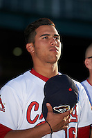 Peoria Chiefs pitcher Derian Gonzalez (16) during the national anthem before a game against the Dayton Dragons on May 6, 2016 at Dozer Park in Peoria, Illinois.  Peoria defeated Dayton 5-0.  (Mike Janes/Four Seam Images)