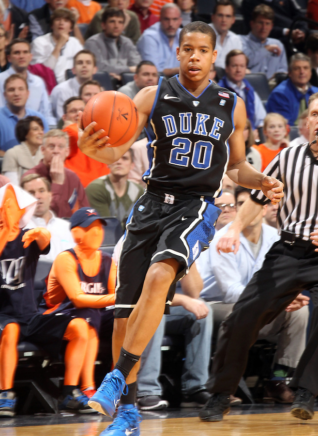 Feb. 16, 2011; Charlottesville, VA, USA;  Duke Blue Devils guard Andre Dawkins (20) handles the ball during the second half of the game against the Virginia Cavaliers at the John Paul Jones Arena. The Duke Blue Devils won 56-41.  Credit Image: © Andrew Shurtleff